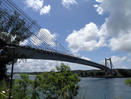 Koror-Babeldaob Bridge, Palau.  The Koror-Babeldaob Bridge is a bridge in Palau that connects Koror and Babeldaob Islands. It is a reinforced concrete, portal frame, cable-stayed bridge with a total length of 413 m. It was built by the Kajima Corporation