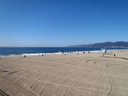 well groomed Santa Monica Beach with a A lifeguard station in view Los Angeles California.  photo
