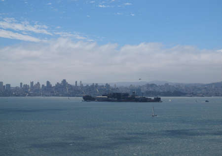 Alcatraz Island and  San Francisco with boats and helicopters moving around in the middle of San Francisco Bay   Taken Angel Island photo