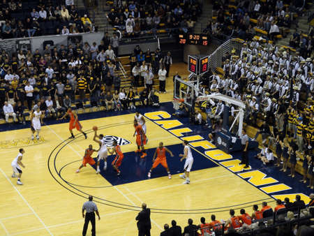 cal: BERKELEY, CA - JANUARY 27: Cal Vs. Oregon State - Cal Player in motion to pass ball at the Haas Pavilion taken January 27, 2011 Berkeley California.