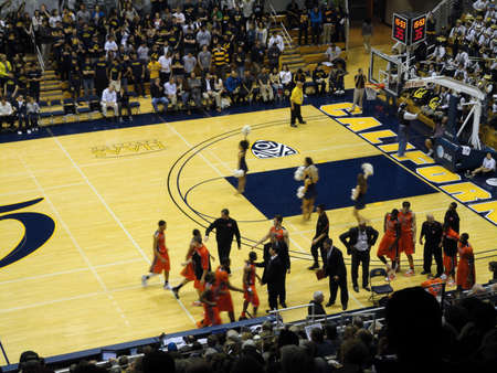state of oregon: BERKELEY, CA - JANUARY 27: Cal Vs. Oregon State -  Oregon State Players run towards bench at start of time out with Coach Craig Robinson, brother to Michelle Obama, standing with hands on hips, at the Haas Pavilion taken January 27, 2011 Berkeley Californ Editorial
