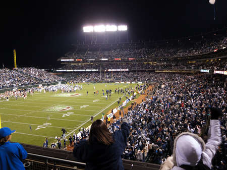 SAN FRANCISCO - JANUARY 9: Fight Hunger Bowl - UNR vs. BC: UNR Fan Cheer as players rush the field at the end of the game ATT Park in San Francisco California, January 9, 2011.