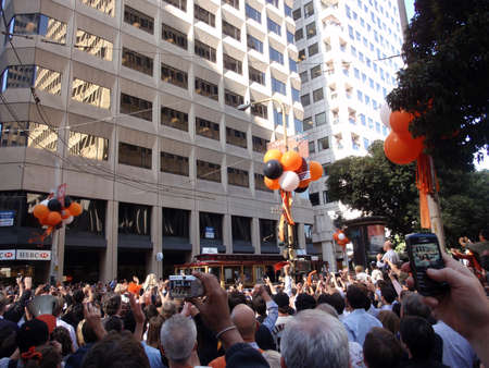 SAN FRANCISCO, CA - NOVEMBER 3: Giants fans celebrate the passing of trolleys featuring giants during world championship parade with fans waving and taking photos with cameras and cellphones Nov. 3, 2010 San Francisco, CA.