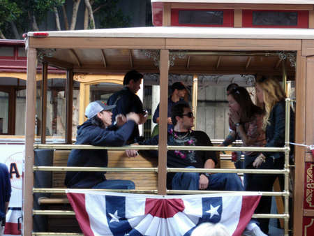 SAN FRANCISCO, CA - NOVEMBER 3: Giants Tim Lincecum wearing a Red Bull hat and dan runzler sit on Trolley and talk story before the start of world championship parade Nov. 3, 2010 San Francisco, CA.