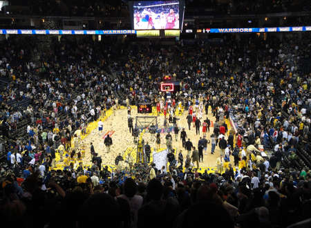 OAKLAND, CA - JANUARY 17: Nets Vs. Warriors: Basketball Players celebrate the finishing of game as confetti fills the air. Taken January 17, 2011 Oracle Arena Oakland, CA.
