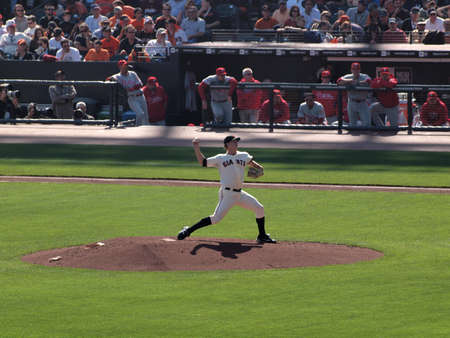 ca he: SAN FRANCISCO, CA - OCTOBER 19: San Francisco Giants vs. Philadelphia Phillies: Pitcher Matt Cain steps into leg to build power as he steps into a throw game three of the NLCS 2010 taken October 19, 2010 AT&T Park San Francisco California.