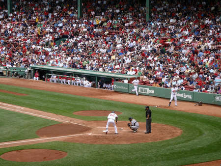 BOSTON - JUNE 2: Red Sox vs Athletics:Red Sox Player steps into the batters box with As Kurt Suzuki catching. taken from the bleachers June 2, 2010 Fenway Park Boston, Massachusetts.