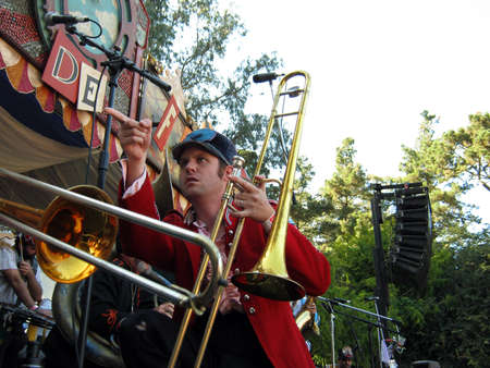 SAN FRANCISCO - SEPTEMBER 25:  Horn player of Mucca Pazza points across the stage during performance at Tour De Fat 2010 include electric guitars, ukuleles, cheerleaders and lots of brass.   September 25, 2010 Golden Gate Park San Francisco.
