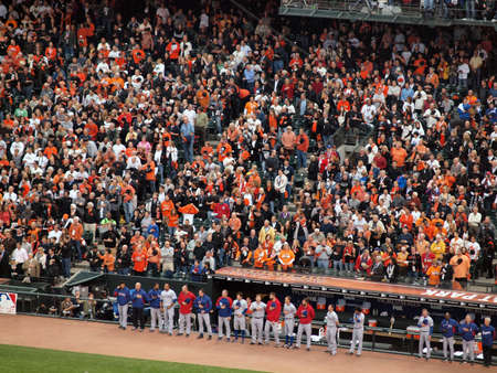 SAN FRANCISCO, CA - OCTOBER 28: Ranger Players stand with hats removed in front of the dugout during national anthem as do fans in the stands game 2 of the 2010 World Series game between Giants and Rangers Oct. 28, 2010 AT&T Park San Francisco, CA.