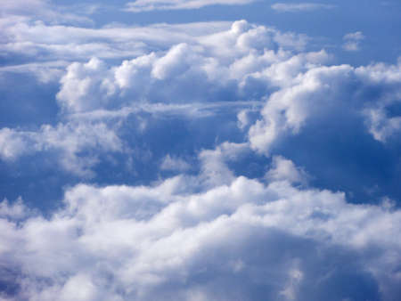 floating above and on top of fluffy curvy spaced clouds with a light blue sea underneath Stock Photo - 8987414
