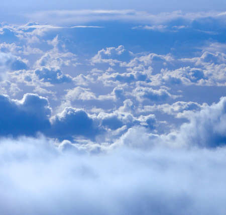 floating above and on top of fluffy curvy clouds as far as the eye can see photo