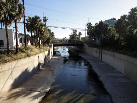 Small river flows down waterway in Culver City, LA. photo