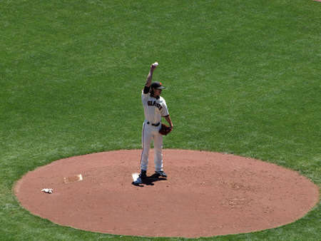 SAN FRANCISCO - JUNE 10: Giants vs. Orioles - pitcher Tim Lincecum lifts arm to the sky as he prepares to throw a pitch taken June 10 2010 at Att Park San Francisco California.