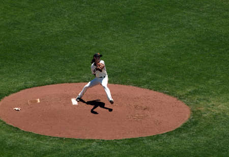SAN FRANCISCO - JUNE 10: Giants vs. Orioles - Giants pitcher Tim Lincecum steps forward to throw a pitch taken June 10 2010 at Att Park San Francisco California.