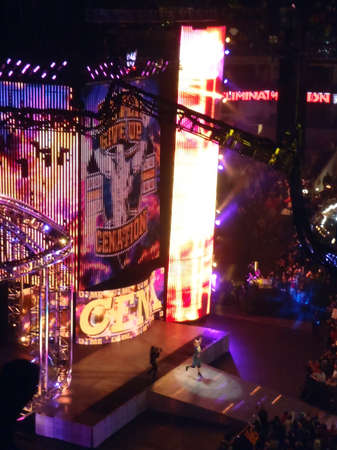 ca he: OAKLAND, CA - FEBRUARY 20: John Cena raises hands into air as he walks toward Ring during Elimination Chamber Pay-Per-View at Oracle Arena taken February 20, 2011 Oakland California.
