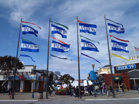 SAN FRANCISCO, CA - MARCH 20: Pier 39 Flags wave in the wind as people check out Nintendp 3DS booths taken March 20, 2011 Pier 39 San Francisco Ca.