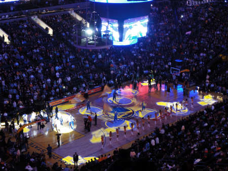 OAKLAND, CA - FEBRUARY 22: Celtics vs. Warriors: Start of game light show goes on as cheerleaders pump up fans  at Oracle Arena taken February 22, 2011 Oakland California.
