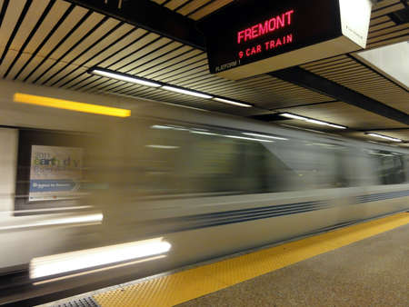 OAKLAND, CA - APRIL 20: BART Train speeds into Lake Merritt station platform. April 20, 2011 Oakland California