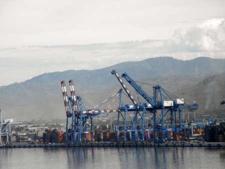 MANZANILLO, MEXICO - JANUARY 11: Shipping Cargo Cranes along the shore of Manzanillo, Mexico. January 11, 2010  Manzanillo, Mexico.  Editorial