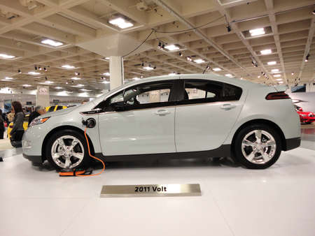 volts: SAN FRANCISCO, CA - NOVEMBER 20: Plug-in Hybrid car the Chevy Volt on display on a spinning platform is displayed at the 53rd International Auto Show, on Saturday November 20, 2010 San Francisco CA.