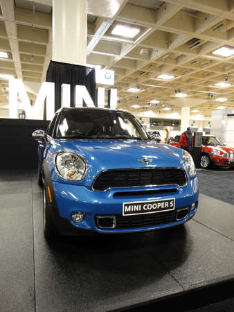 cooper: SAN FRANCISCO, CA - NOVEMBER 20: Front side of Blue Mini Cooper S on Display at the 53rd International Auto Show November 20 2010 San Francisco.