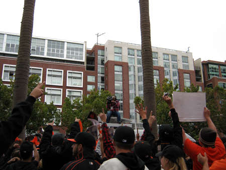 SAN FRANCISCO - OCTOBER 2: Padres vs. Giants: Giants Fans go crazy for Cameraman on top of TV Van by waving and holding signs after winning the NL West Division. taken on October 3 2010 at Att Park in San Francisco California.  Stock Photo - 9433869