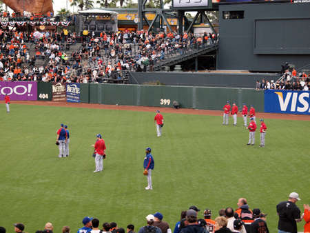 SAN FRANCISCO, CA - OCTOBER 28: Rangers players standing in the outfield taking balls during batting practice game 2 of 2010 World Series game 2between Giants and Rangers Oct. 28, 2010 AT&T Park San Francisco  Stock Photo - 9433932