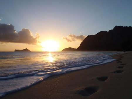 sunrises: Sunrises on Waimanalo Beach over Rock Island next to Rabbit Island by Makapua Point on Oahu, Hawaii.
