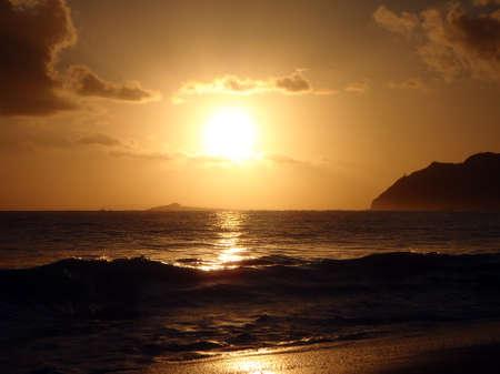 Sunrises over Rock Island by Maka'pua Point on Oahu, Hawaii.