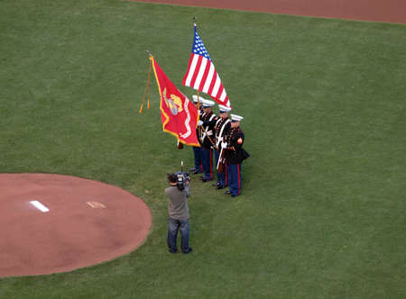 anthem: SAN FRANCISCO, CA - OCTOBER 20: Marines hold flags during national anthem game 4 of the 2010 NLCS game between Giants and Phillies Oct. 20, 2010 AT&T Park San Francisco. Marines hold flags during national anthem