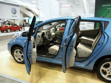 electric automobile: SAN FRANCISCO, CA - NOVEMBER 20:Nissan Leaf on display with Car doors open at the 53rd International Auto Show on November 20, 2010 in San Francisco, CA.  Editorial