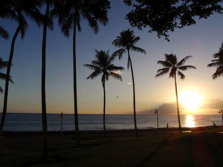 state of mood: Sunset over Kakakoo Park in Honolulu along the wide open pacific ocean. Stock Photo