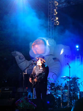 primus: SONOMA, CA - JUNE 11: Lead singer of Primus sings on stage with blue lights and mist shining on him at Harmony Festival 2011 on June 11, 2011 in Sonoma, CA.  Editorial