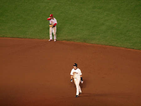 shortstop: SAN FRANCISCO, CA - OCTOBER 20: Giants Buster Posey takes lead from Second Base with Jimmy Rollins at Shortstop behind him game 4 of the 2010 NLCS game between Giants and Phillies Oct. 20, 2010 AT&T Park San Francisco, CA.