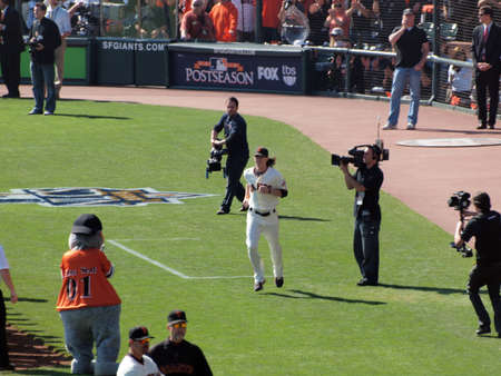 introductions: SAN FRANCISCO, CA - OCTOBER 19: Giants vs. Phillies: Giants Pitcher Tim Lincecum runs on to field during introductions before game 3 NLCS 2010 October 19, 2010 AT&T Park San Francisco.  Editorial
