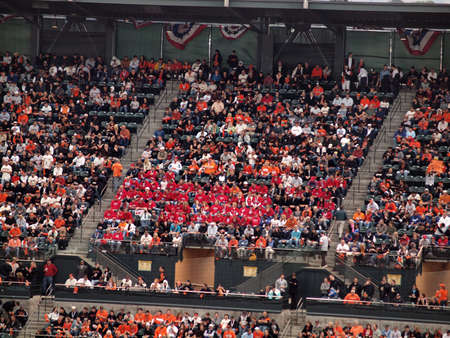 baseball crowd: SAN FRANCISCO, CA - OCTOBER 28:Pack red shirt Ranger fans in the stands among Giants Fans game 2 2010 World Series game between Giants and Rangers Oct. 28, 2010 AT&T Park San Francisco.
