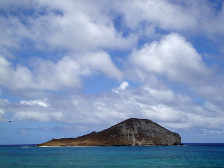 Rabbit Island in Waimanalo Bay off the coast of Oahu, Hawaii with bird flying by. Stock Photo - 10753886
