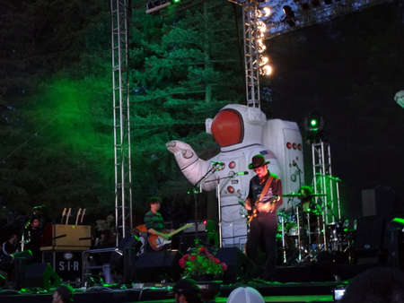 primus: SONOMA, CA - JUNE 11: Primus jams guitars on outdoor stage at night at Harmony Festival 2011 on June 11, 2011 in Sonoma, CA.