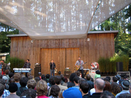 SAN FRANCISCO - AUGUST 22: 73rd Stern Grove Festival: They Might Be Giants singing into mics on stage at am outdoor concert August 22 2010 San Francisco CA.  Stock Photo - 10738921