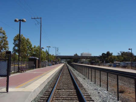 Commuter Train Tracks stretch into the distance in California photo