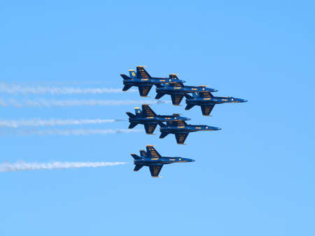 SAN FRANCISCO - OCTOBER 10: Six Blue Angels fly in a super tight triangle formation as afterburns fire taken October 10, 2010 San Francisco