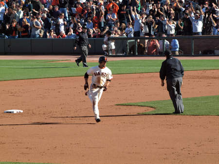 SAN FRANCISCO -July 28: Giants Andres Torres passes 2nd base as he rounds the Bases taken on July 28 2011 at Att Park in San Francisco California.