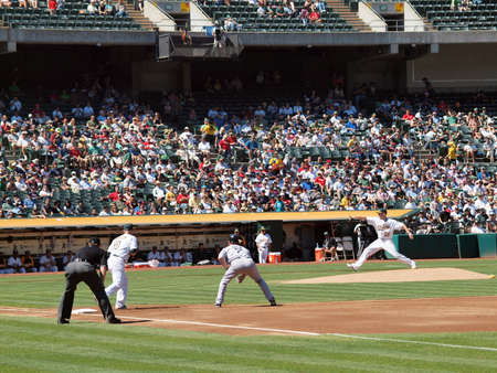 Red Sox vs. A's: JD Drew takes lead as Dallas Bredan steps foward to throws pitch.  September 12 2010 Coliseum Oakland California