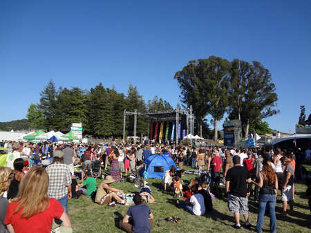 SONOMA, CA - JUNE 11: Crowd watches band jam outdoors on stage at the Harmony Festival 2011 on June 11, 2011 in Sonoma, CA.