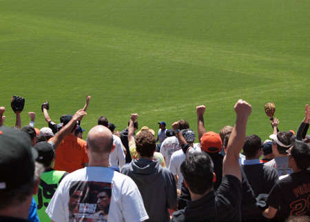 SAN FRANCISCO, CA - AUGUST 12: Giants Fans raise hands into the air to cheer at AT&T Park on August 12, 2010 in San Francisco.