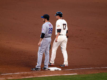 begins: SAN FRANCISCO, CA - JULY 17: Giants Aubrey Huff begins to take lead from 1st base next to Mets Ike Davis at ATT Park on July 17 2010 in San Francisco.