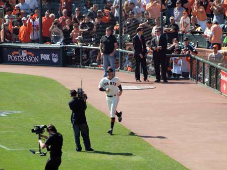 introductions: SAN FRANCISCO, CA - OCTOBER 19: Giants vs. Phillies: Giants Barry Zito runs on to the field during introductions before start of game three NLCS 2010 taken October 19, 2010 AT&T Park San Francisco.
