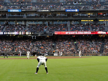 outfielders: SAN FRANCISCO, CA - JUNE 6: Outfielder Cody Ross squats ready for play action with runner taking lead from 3rd base at ATT Park on June 6 2011 in San Francisco. Editorial