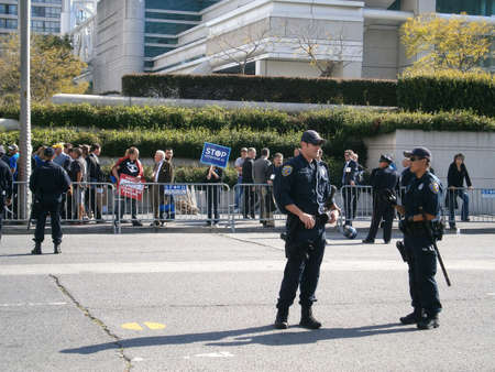 SAN FRANCISCO, CA - OCTOBER 25: SFPD stand in street during Protest of the Presidents fundraiser trip to the W Hotel on Howard street  on October 25 2011 in San Francisco.