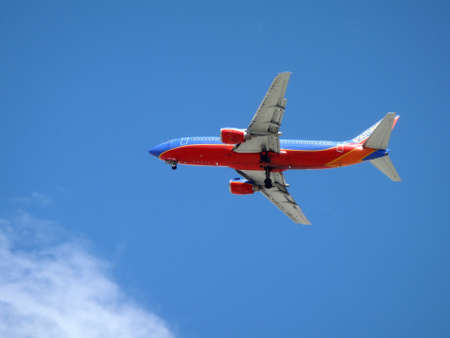 LAS VEGAS - NOVEMBER 14: Jumbo Jet Southwest airline Plane flies overhead with wheels dropped as it sets to land at Mccarran airport in Las Vegas, USA on November 14, 2010. Editorial